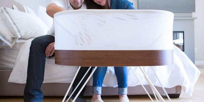 Couple with Snoo Smart Sleeper-min